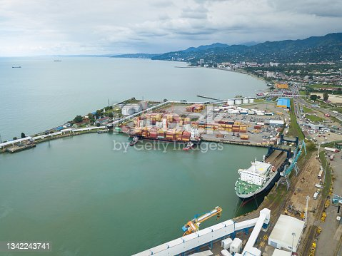 istock Drone view of the sea port of Batumi, ferry, barge, mountains on a summer day 1342243741