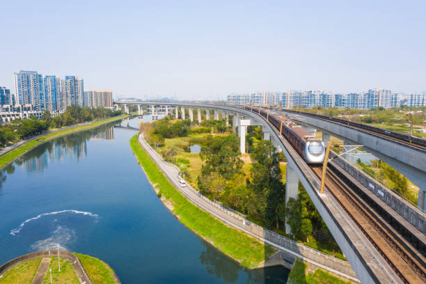 Drone view of West Rail Line in Yuen Long District, Hong Kong Drone view of West Rail Line in Yuen Long District, Hong Kong railway bridge stock pictures, royalty-free photos & images