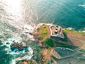 drone view from bay on coastline of Salvador da Bahia with lighthouse