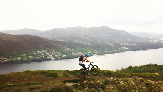 Drone view over a group of mountain bike riders: MTB biking outdoor in Norway