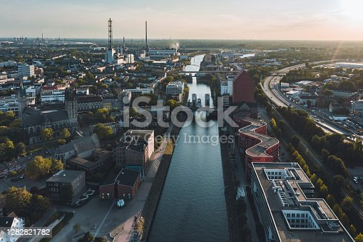 istock drone view over canal in old harbor of Duisburg at sunset 1282821782