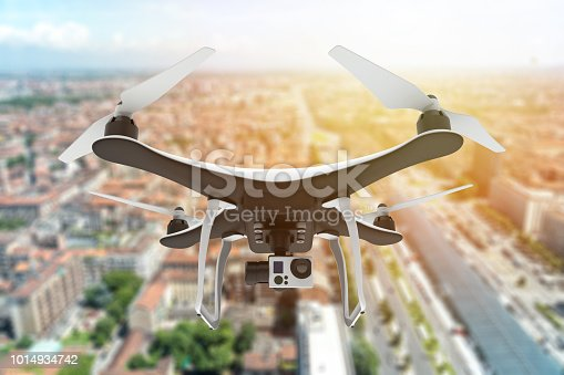 istock Drone with digital camera flying over a city 1014934742