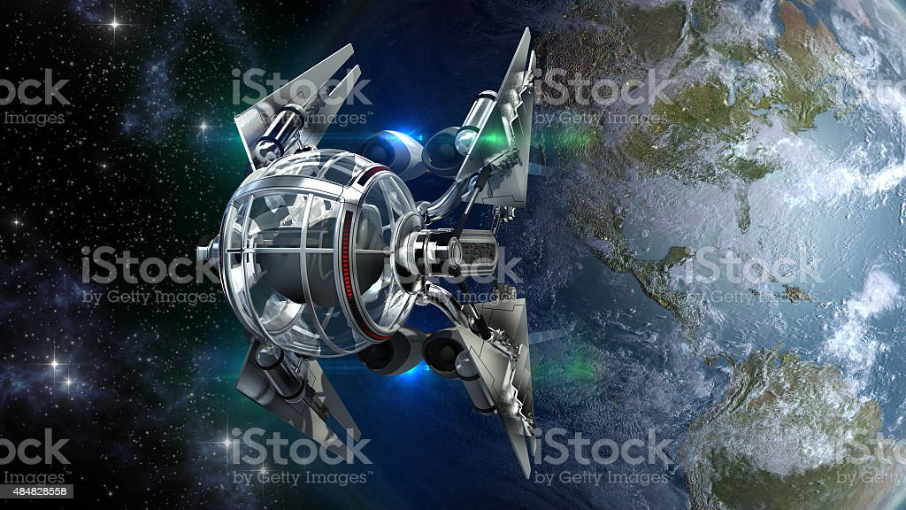 Drone-like spaceship leaving Earth stock photo