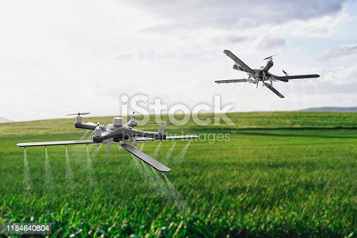 898449496istockphoto Drones spraying a field 1154640804
