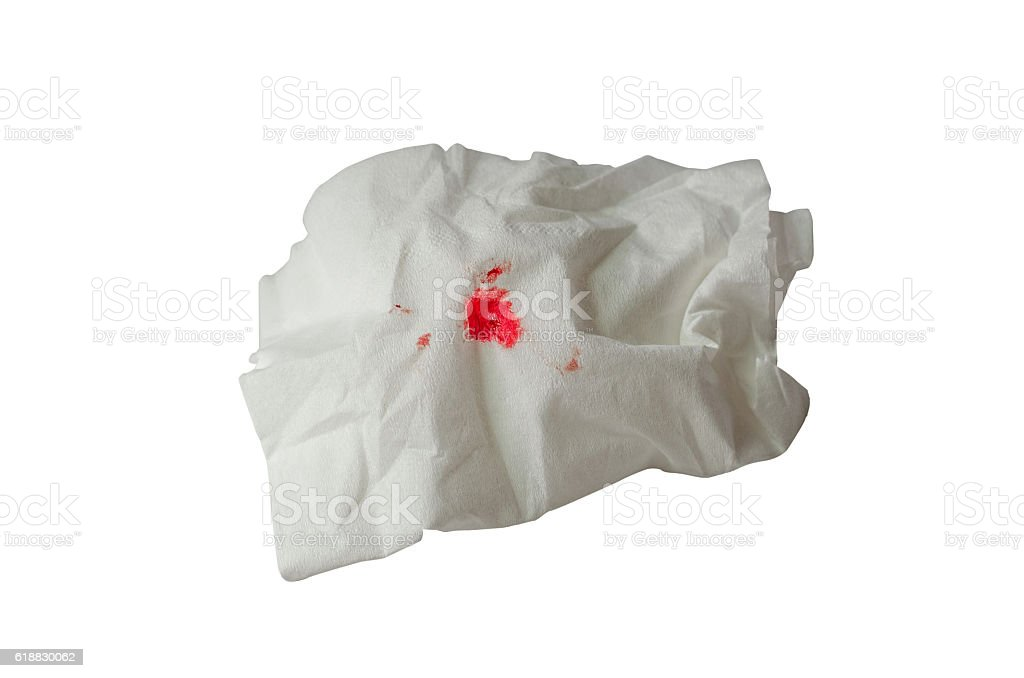 Drop of blood on paper white background stock photo