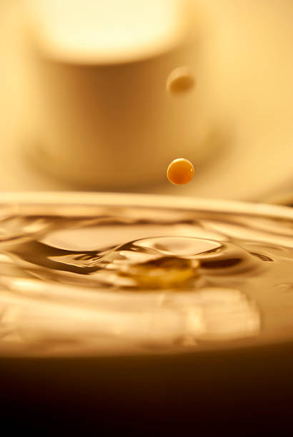 Drop of coffee creamer stock photo