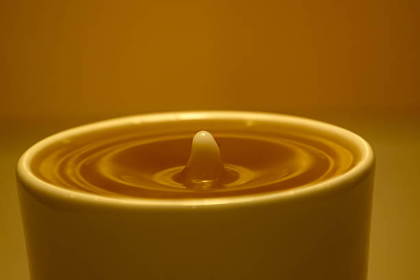 Drop of Creamer in Coffee stock photo