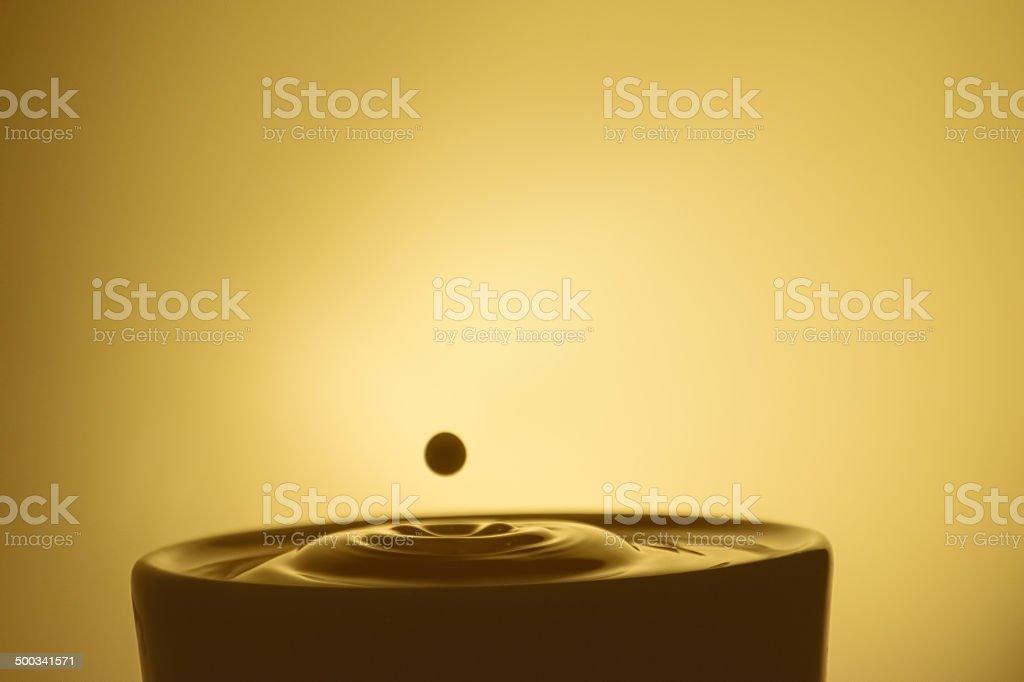 Drop of Creamer in Coffee stock photo