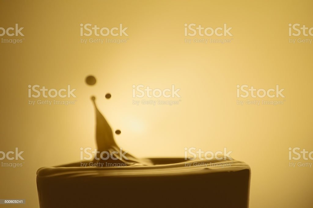 Drop of Creamer in Coffee - Royalty-free Backgrounds Stock Photo