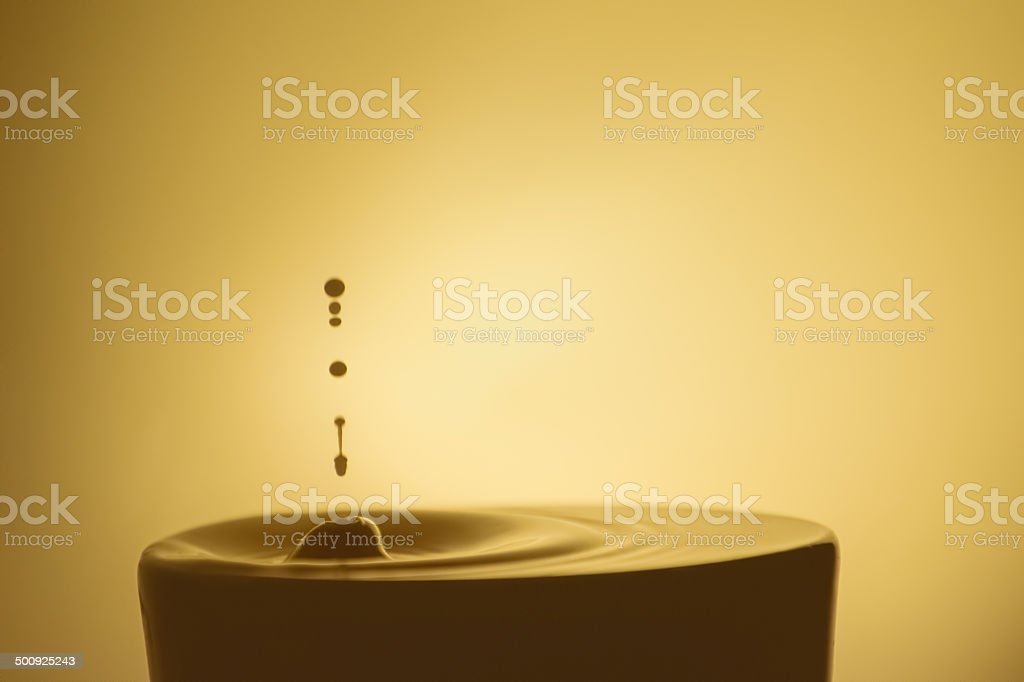 Drop of Creamer in Coffee royalty-free stock photo