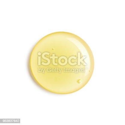 Drop of honey isolated on white background
