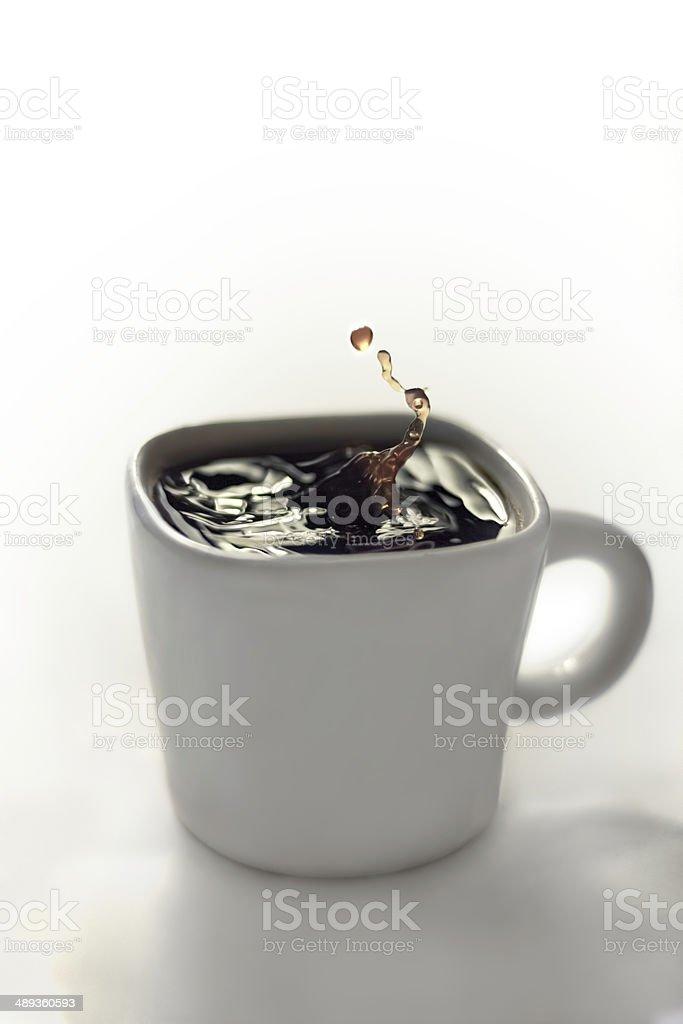 Drop splash in coffee stock photo