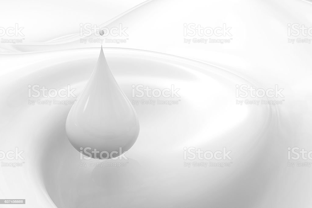 droplet of milk on white background stock photo