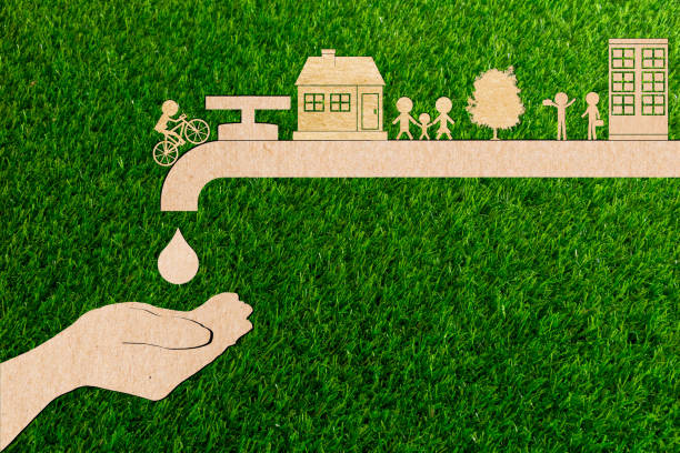 droplet tap live water save ecology concept of paper cut tree green grass. - tap water zdjęcia i obrazy z banku zdjęć