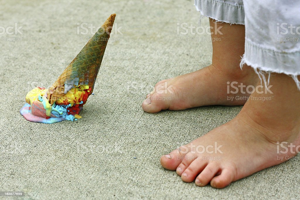 Dropped Ice Cream Cone by Feet stock photo