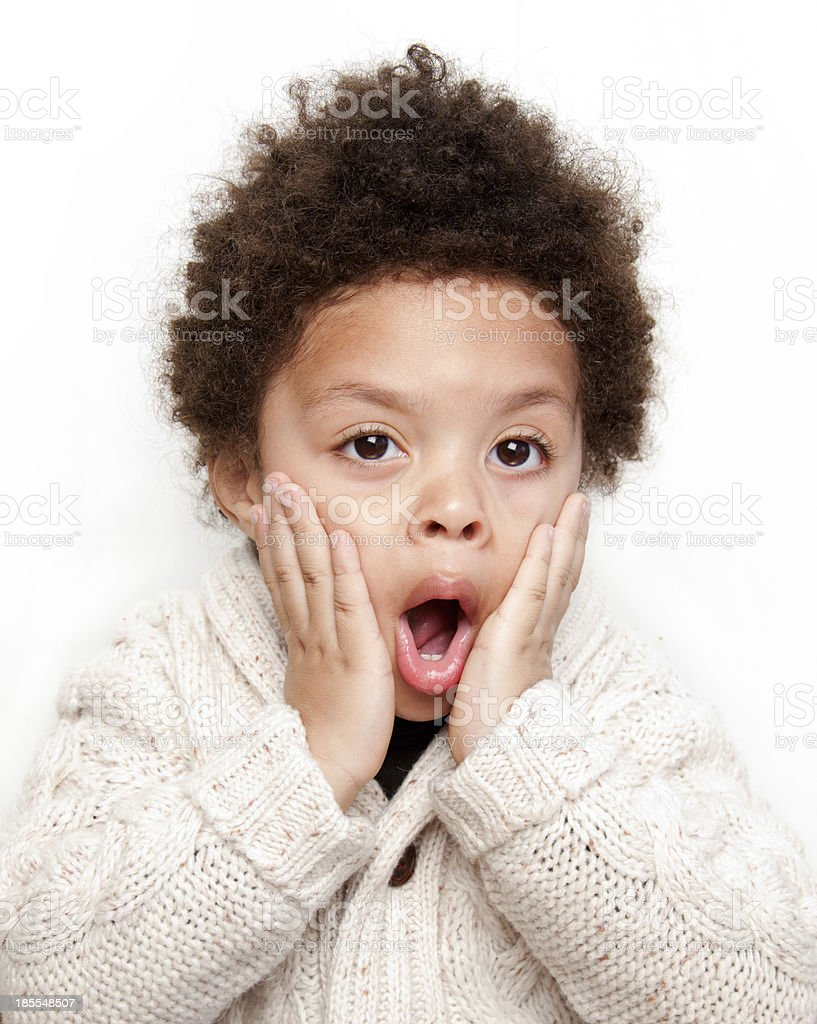 Dropped jaw surprised child with hands on face stock photo