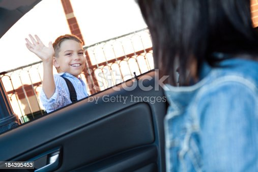 istock Dropped off at school, boy waves to mom 184395453