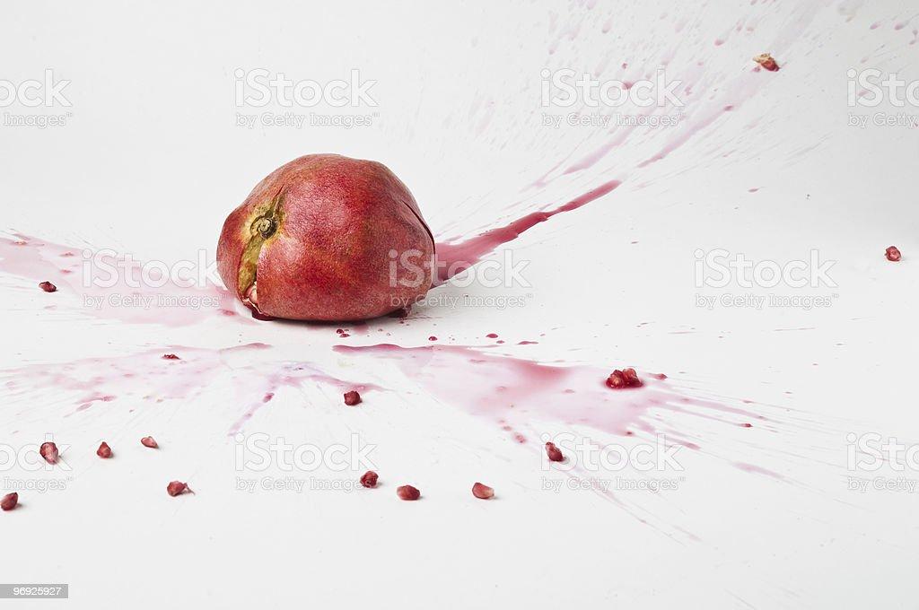 dropped,smashed pomegranate royalty-free stock photo