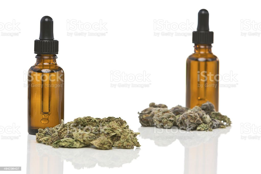 Dropper bottles with cannabis or hemp oil isolated on white stock photo