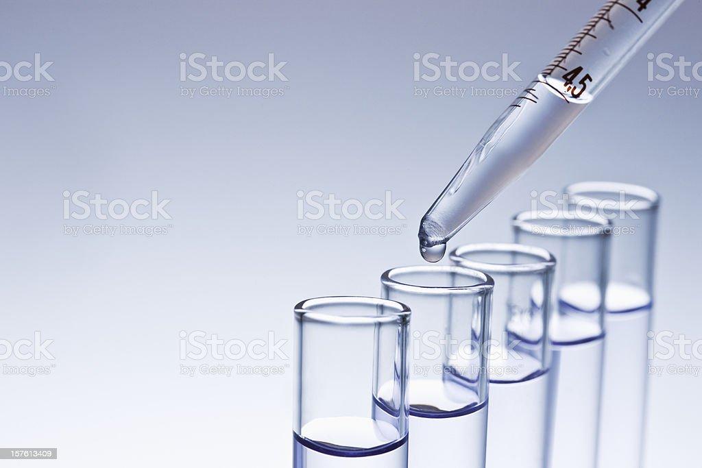 Dropper Filling Test Tubes stock photo