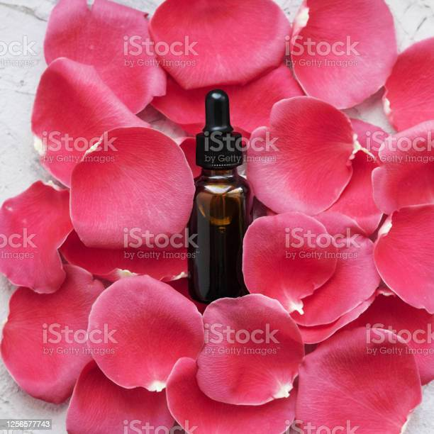 Dropper with natural essential oil on red rose petals picture id1256577743?b=1&k=6&m=1256577743&s=612x612&h=plu3mpifcpzb1o sjku77qaz67lekcakjqxdgse91ty=