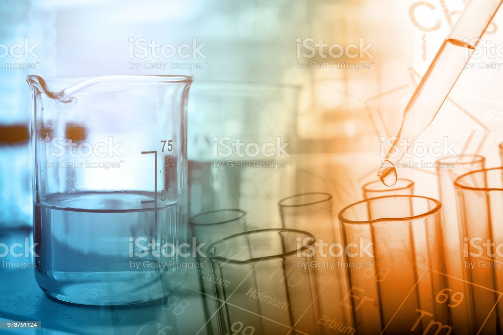 Dropping chemical liquid to test tube with lab glassware background,...