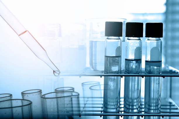 Dropping Chemical liquid to test tube with lab glassware, science research and development concept stock photo