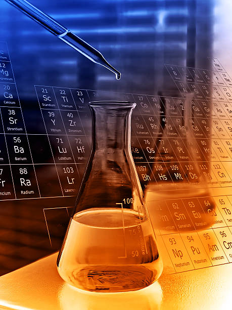 Dropping chemical to flask stock photo