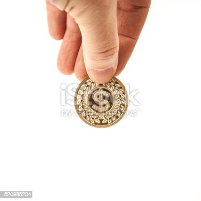 Aucasian hand holding a gold coin with the $ money symbol on it.  White background. Horizontal.  Easy to clip. Bitcoin