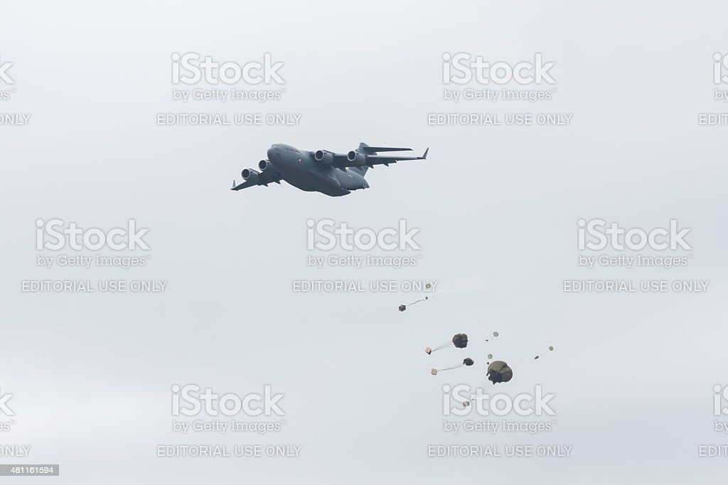 C-17 Dropping Paratroopers stock photo