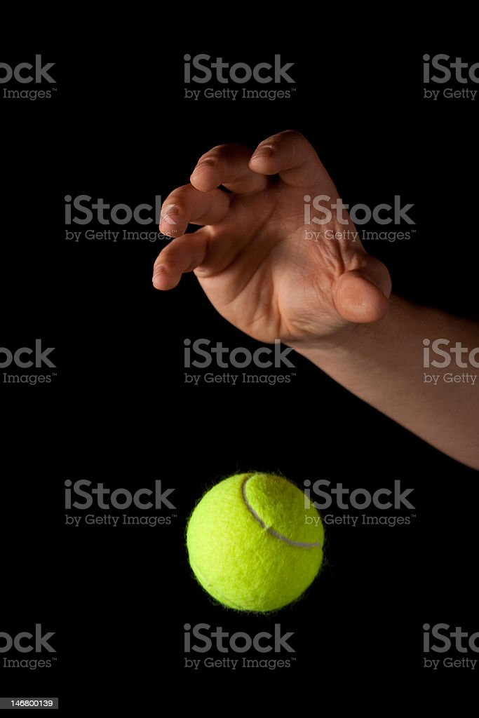 Dropping the Tennis Ball stock photo