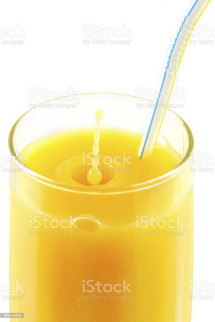 drops falling down to orange juice stock photo