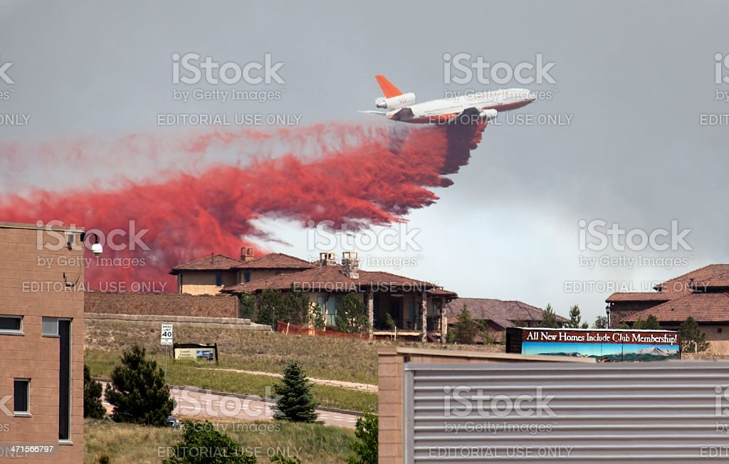 DC-10 drops fire retardant near Colorado Springs homes stock photo