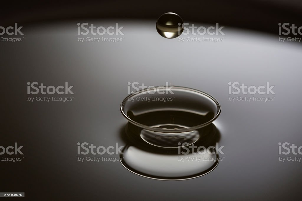 Drops of engine oil on metall surface stock photo