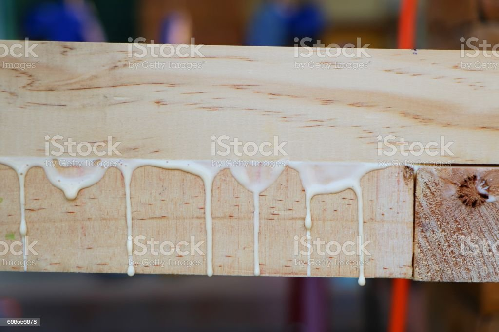 Drops of glue while Assembling a furniture stock photo