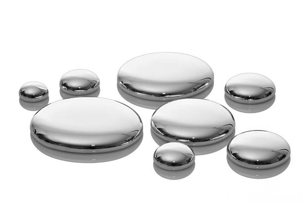 drops of mercury isolated on white. - mercury metal stock photos and pictures