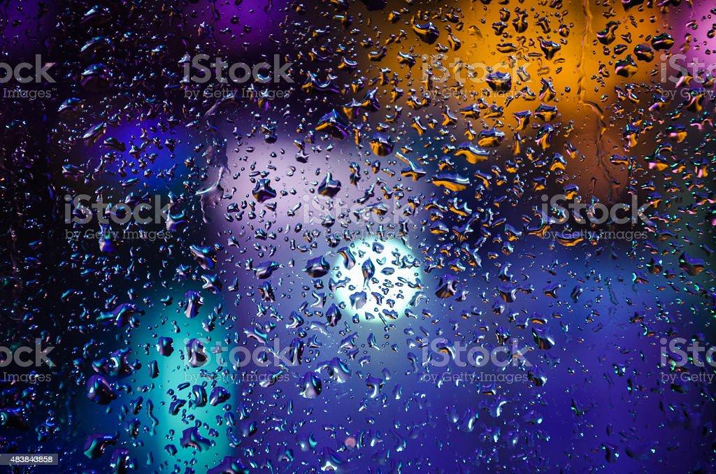 Drops of night rain on window, abstract background stock photo