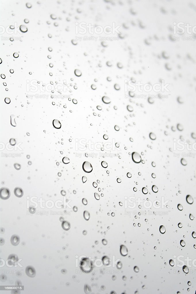 Drops of rain on the inclined window royalty-free stock photo