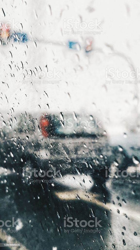 Drops of rain on the window car. View from car on road in the rainy...