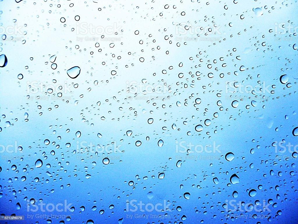 Gocce Su Una Superficie Trasparente Con Sfondo Blu Fotografie