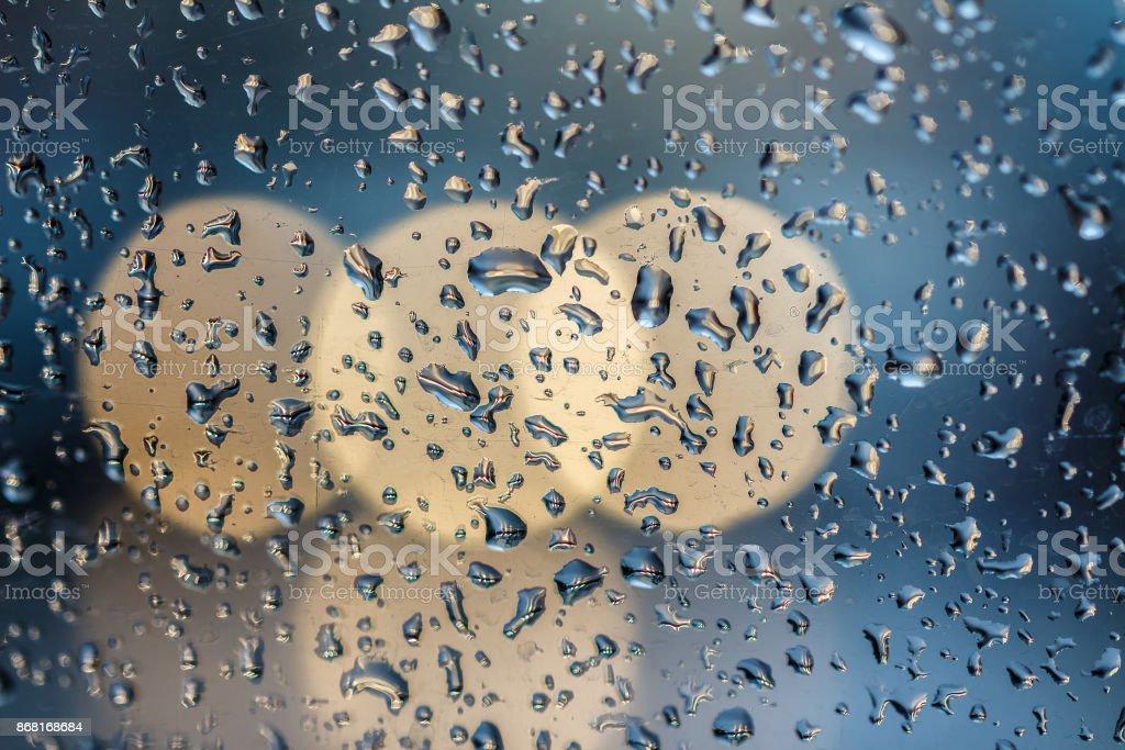 Drops on glass bokeh stock photo