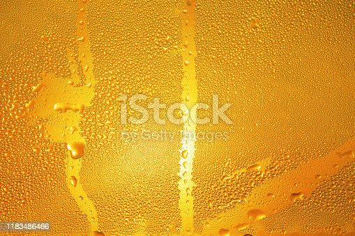 istock drops on the beer bottle 1183486466