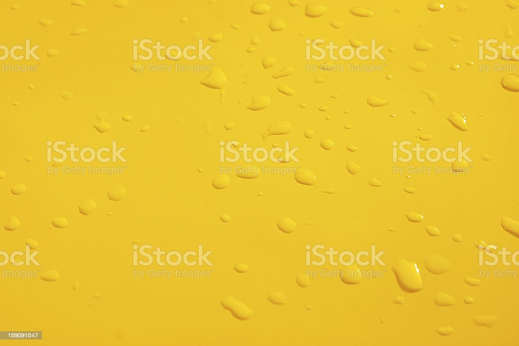 drops on yellow surface royalty-free stock photo