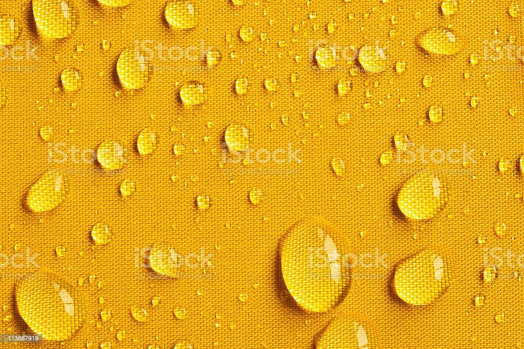 Drops on Yellow Umbrella stock photo