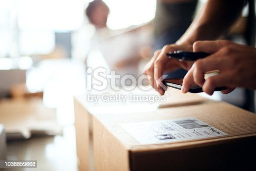 Worker from startup dropshipping company preparing sticker for the package.