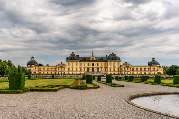 Drottningholm Palace building seen from the open English garden. stock photo