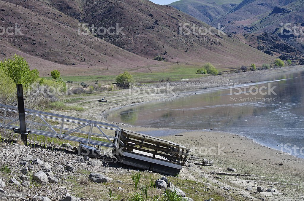 Drought Conditions - Floating Pier on Ground at Empty Reservoir stock photo