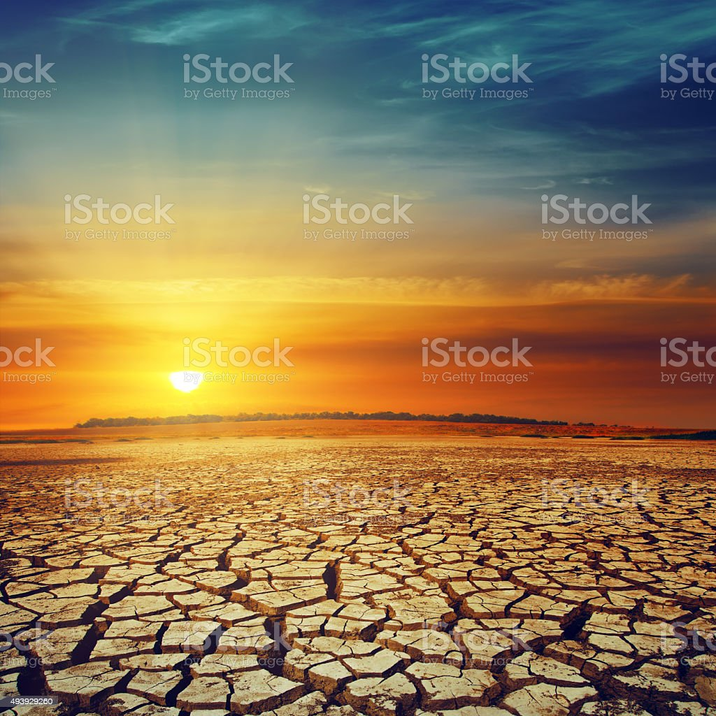 drought land and sunset over it stock photo