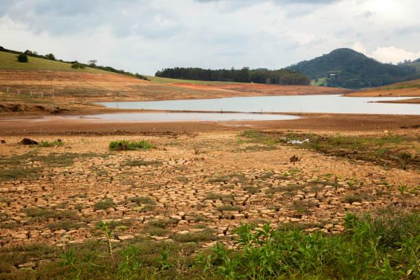 Drought soil in brazilian cantareira dam stock photo