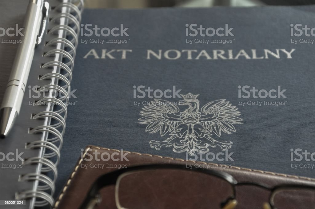 Drowing up notarial act. 'Akt notarialny' means 'notarial act'. stock photo